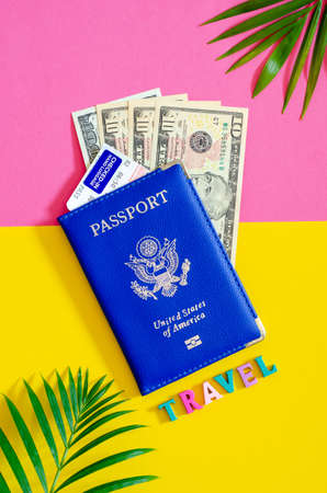 United States passport with us dollars and airplane ticket, tourism concept.