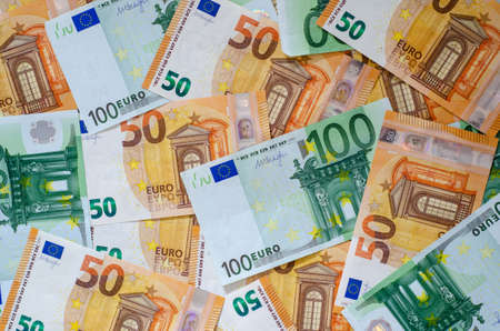 Background of many euro currency notes.