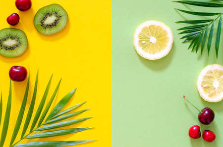 Bright colorful background with exotic painted tropical palm leaves and fruit.