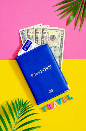 Passport with us dollars and airplane ticket, tourism concept.