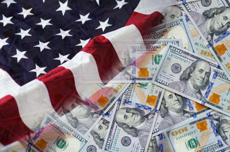 Background of one hundred United states of America US dollars currency with United states flag.