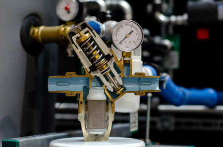 Pressure reducing valve. With filter and pressure gauge. Cross section