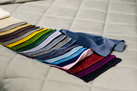Colorful upholstery fabric samples in the store. Types Of Fabrics.
