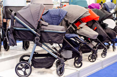 Baby pushchairs for sale in the store Stockfoto