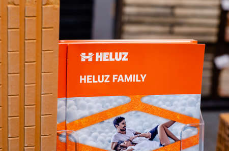 Kyiv, Ukraine - March 17, 2021: HELUZ exhibition stand. HELUZ COMPANY are engaged in production of bricks since 1876.