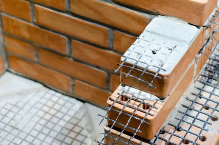 Modern layout of the construction of walls with brick masonry. External wall insulation systems
