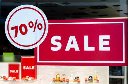 Sale 70% off banners in a shop window Stock fotó