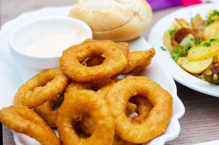 Squid rings in batter with garlic sauce. Stock fotó