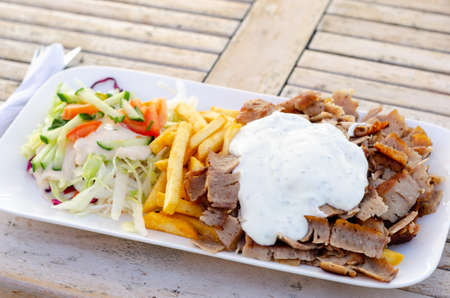 Doner meat with french fries and salad Stock fotó