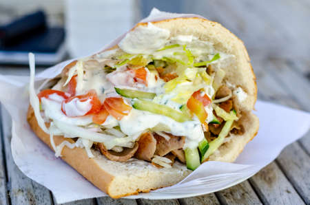 Doner kebab as a sandwich. Doner kebab is a type of kebab, made of meat cooked on a vertical rotisserie. Stock fotó