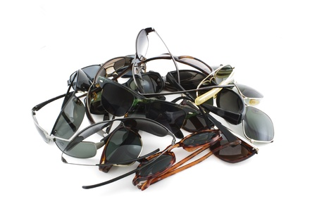 several pile up sunglasses on white background Stock Photo - 13181919