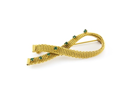 Beautiful golden brooch with green stones on white Stock Photo - 13181927