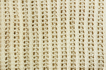 Close-up of a woolen pattern. Knitting pattern  photo