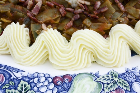 creamed: green beans with bacon and creamed potatoes on ceramics plate