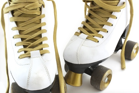 roller skates: a pair of white and gold rollerskates