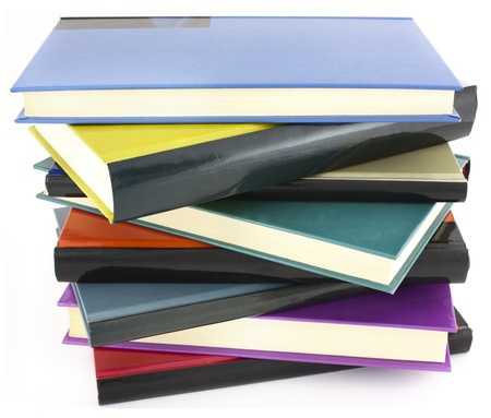 pile of color hardcover books over white background photo