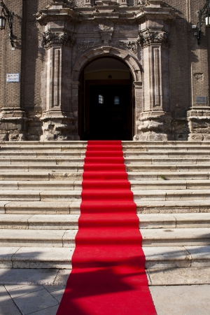Red carpet on the staircase to the church photo