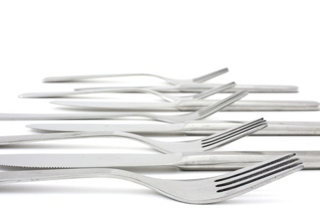 several forks and knife forming a pattern photo