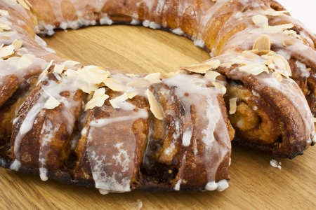 roll cake of caramel with almond and sugar glass photo