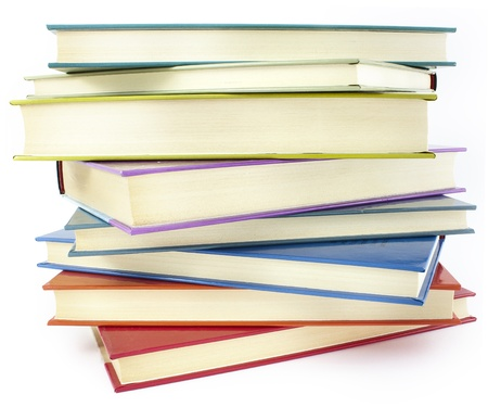 hardcover: pile of color hardcover books over white background