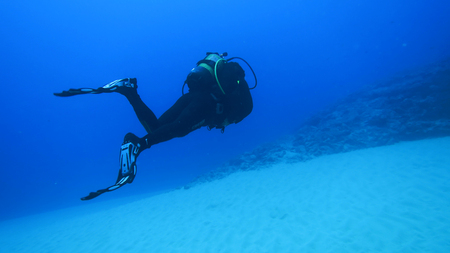 Silhouette scuba diving. Stock Photo