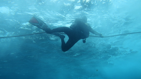 aqualung: Silhouette scuba diving. Stock Photo