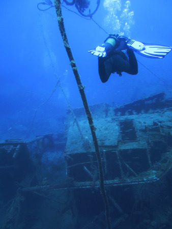 aqualung: Scuba diving. sunken ship