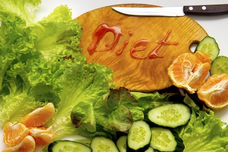 alimentacion balanceada: Composition with fresh organic vegetables and fruits and Cutting board with the inscription diet. Foto de archivo