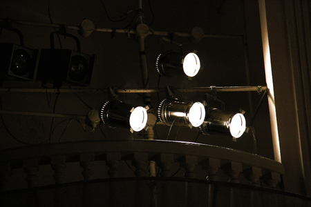staging: many spotlights that illuminate the stage at a concert hall in theatre.