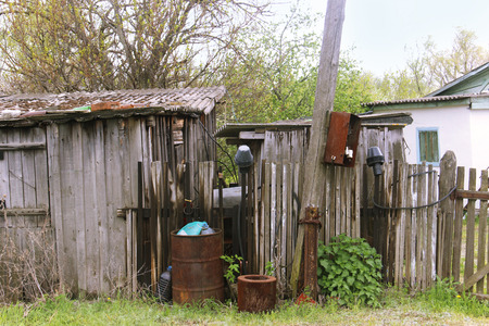 outbuilding: Old farmhouse and outbuildings on a suburban site. Stock Photo