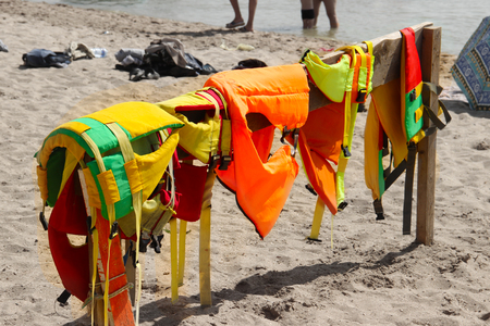 banana: Colorful life jackets save your life. Safety in water. Rescue service on the beach. Injuries to water attractions. be carefull.