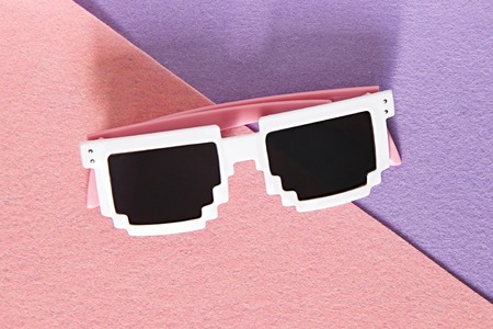 White Pixel glasses on a pink and purple background.