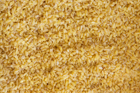 Bulgur wheat yellow background and texture pattern. Stock fotó