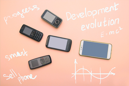 evolution of cell phones. Technology development telephone and pda concept. Vintage and new phones. Top view. Telephone communication progress, mobile classic device . charts, arrows, text around