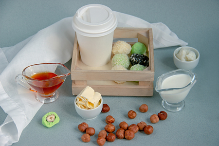 Fat keto peanut butter, matcha balls and matcha coconut bulletproof and white paper cup for coffee break with a lid. keto protein balls and coffee recipes ingredients. it works ketogenic diet Imagens