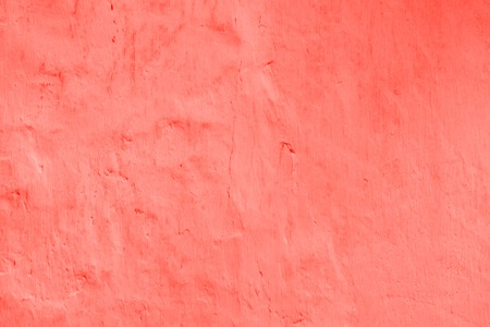 Living Coral color of the Year 2019 abstract background. plastered wall with decorative plaster main trend of the season. Imagens