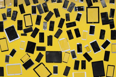 Mobile smartphone the tablet a lot of glass screen damage broken on yellow background