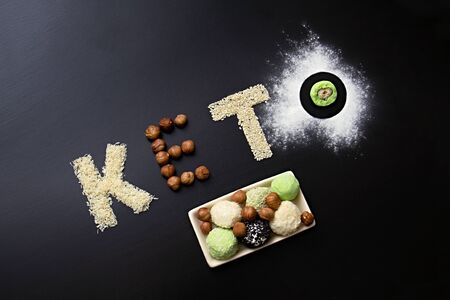 keto protein balls and matcha tea recipes ingredients on dark wooden background make text keto. it works ketogenic diet