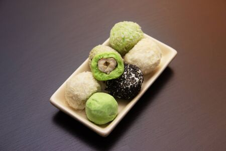 keto protein balls and matcha tea ball recipeson dark wooden background . it works ketogenic diet