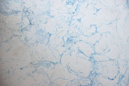 light white with blue interspersion points wall marble texture background tabletop natural stone trim. Archivio Fotografico