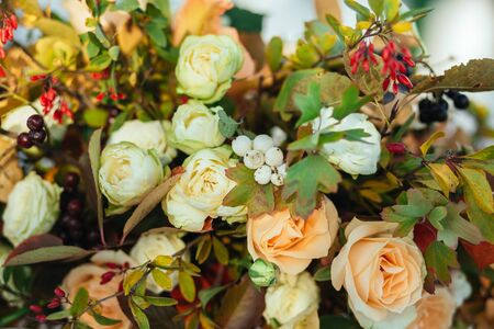Autumn flowers decor, cream beige roses with fall berries, wedding decoration