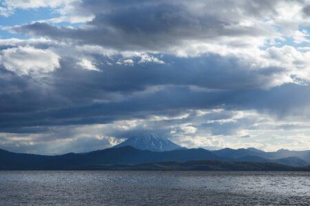 Volcanic seascape in Kamchatka peninsula, Russia. Vilyuchinskiy volcano above the ocean.