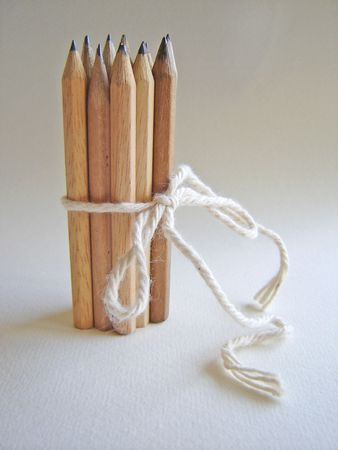 Photograph depicting a group of wooden pencils connected with each other