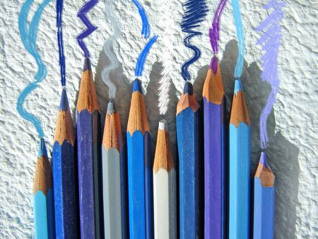 photomontage:             Photomontage showing a group of pencils and graphic signs that they give