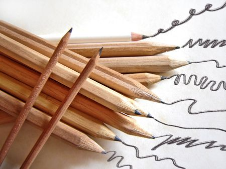photomontage: photomontage of a composition of pencils and leaving traces on the surface                            Stock Photo