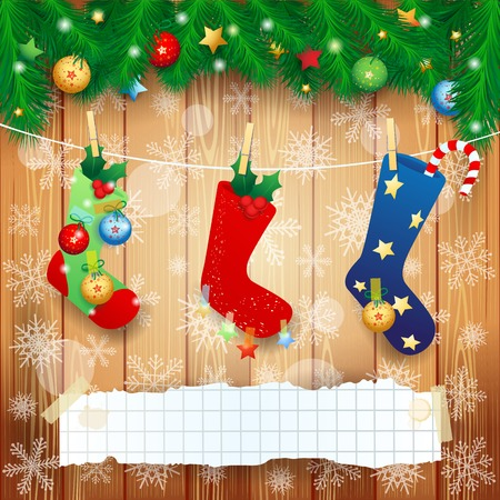 Christmas socks and copy space on wooden background.