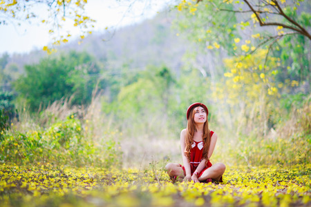 pretty dress: Portrait of a beautiful  girl among yellow flowers in the nature,thailand,asia. Stock Photo