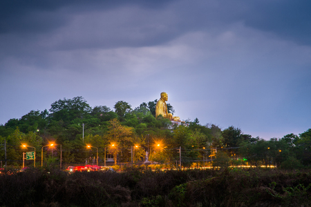 approximately: Wat Doi ti. Big Buddha built in approximately 2011 to the attraction of Lamphun,Thailand. Stock Photo