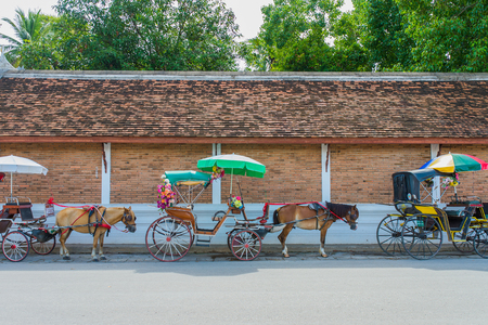 Traditional Horse Carriage ride in Wat Phra That Lampang Luang, Lampang Province, Thailand.