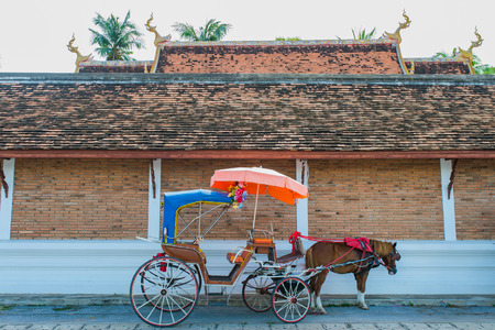 horse pull: Traditional Horse Carriage ride in Wat Phra That Lampang Luang ,Lampang Province, Thailand. Stock Photo